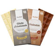 """1x Vollmilch- und 1x Weiße Schokolade mit Süßungsmittel Xylit. Mindestens 42% bzw.35% Kakaobestandteile.Enthält Milchprodukte/Laktose. Versandgewicht: 220 g Zwei Leckereien auf einen Streich im Sparpack. Mit diesenProdukten unterstützen wir den nachhaltigen Anbau von Kakao(UTZ).Entwickelt und produziert in Deutschland. Verpackungsdesign: Ulrike Wilhelm (Berlin).""""Xukkolade"""" und """"Weißolade"""" sind eingetragene Gemeinschaftsmarken der kiwikawa GmbH. Zutaten Vollmilch: Süßungsmittel (Xylit)"""